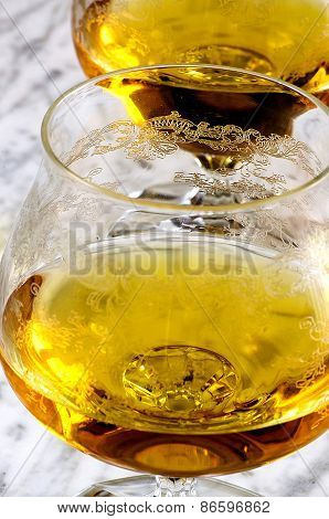 Glass Of Cognac On A Marble Table