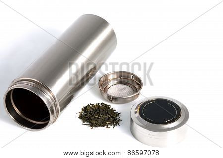 Chinese Personal Thermos With Green Tea Leafs Isolated On White