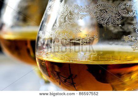 Macro Glass Of Cognac On Gray Background