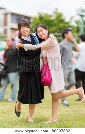 Thai Girl Is Hugging Her Friend Who Graduated A Master Degree .