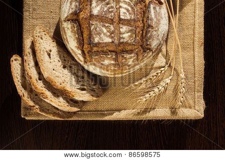 Rustic Bread And Wheat On A Traditional Cloth