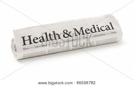 Rolled Newspaper With The Headline Health And Medical