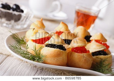 Profiteroles Filled With Red And Black Caviar Horizontal