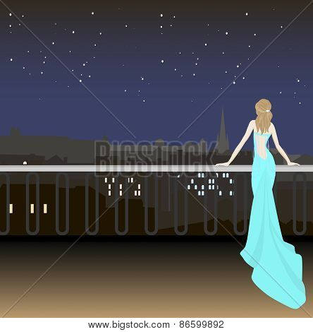 Girl In Evening Dress On The Background Of The City At Night And The Starry Sky
