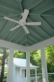 picture of screen-porch  - screen porch with ceiling fan and rafters - JPG