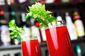 foto of bloody  - Bloody Mary cocktails shot on a bar counter in a night club