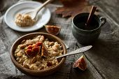 stock photo of porridge  - pearl-barley porridge breakfast in style a rustic on a wooden table