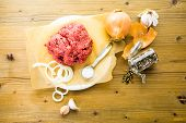 stock photo of ground-beef  - Ground beef on the table with other ingredients for recipe - JPG