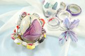 picture of decoupage  - Handmade decoupage Easter egg on a handmade paper decorated with a paper butterfly - JPG