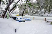 stock photo of ski boat  - a snow covered kayak jet - JPG