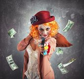 image of stealing  - Clever thief clown thief steals money loot - JPG