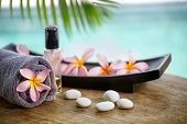 image of massage oil  - Balinese spa setting - JPG
