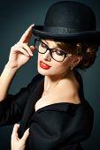 pic of bowler  - Beautiful woman wearing glasses and bowler hat - JPG