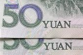 stock photo of yuan  - Two Chinese 50 yuan notes in close up - JPG