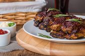 picture of ribs  - Grilled pork ribs in barbecue sauce on white plate - JPG