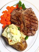 stock photo of baked potato  - A porterhouse  - JPG