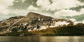 stock photo of snow clouds  - Snow mountain cloud and lake panorama with reflections in Yosemite - JPG