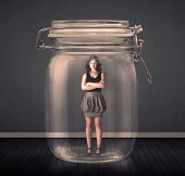stock photo of trap  - Businesswoman trapped into a glass jar concept on background - JPG