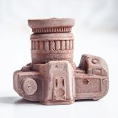 stock photo of edible  - Edible noname nobrand chocolate camera present for photographer  - JPG