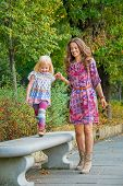 picture of mother baby nature  - Happy mother and baby girl having fun time in city park  - JPG