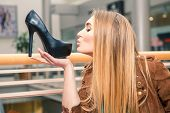 picture of stiletto heels  - Woman kissing shoe - JPG