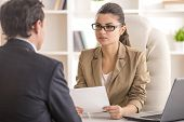 picture of interview  - Businesswoman interviewing male candidate for job in office - JPG