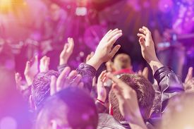 pic of rocking  - Fans Applauding To Music Band for Live Performing a Concert on Stage in Open Arena Selective Focus Toned Image with Sunflares - JPG