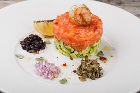 stock photo of tartar  - tartar salad with salmon and avocado - JPG