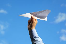image of creativity  - Businessman launching a paper airplane concept for business startup - JPG