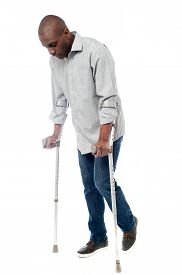 image of crutch  - Man walking with crutches isolated on a white - JPG