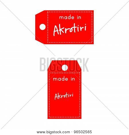 Red Price Tag Or Label With White Word Made In Akrotori Isolated On White Background