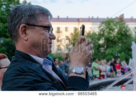 White Man With Glasses And Smartphone
