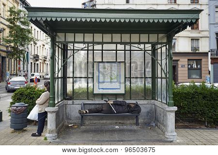 Homeless Sleeping Under A Dirty Tram Shelter