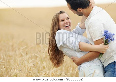 Happy Young Couple Having Fun In Summer Field