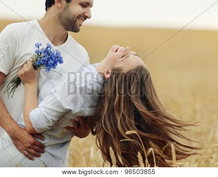 Happy Young Couple Having Fun Outdoor In Summer Field