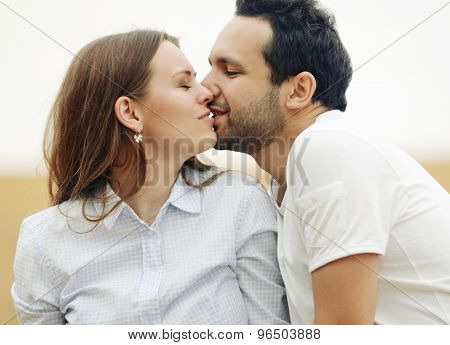 Sensual Young Couple Kissing In Summer Field