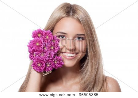 Beautiful happy young woman with flowers
