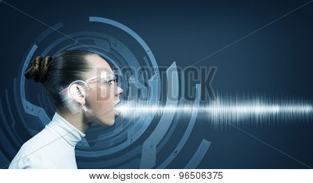 Young woman wearing headphones on digital blue background