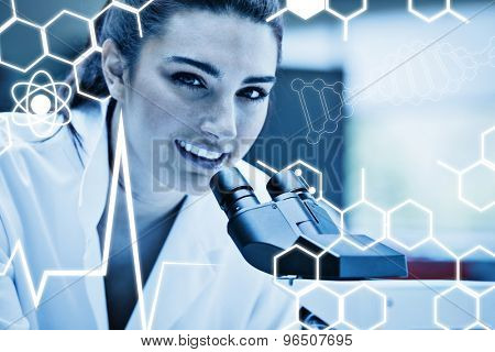 Science graphic against close up of a scientist posing with a microscope