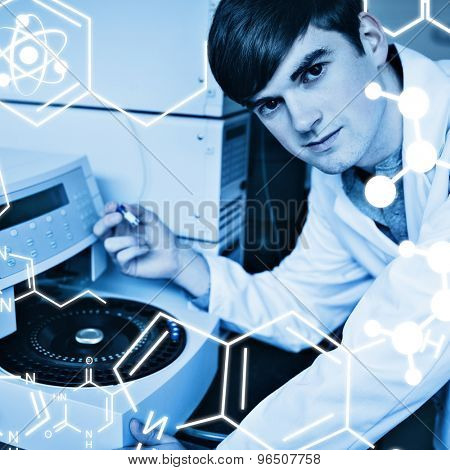 Science graphic against chemist using a centrifuge
