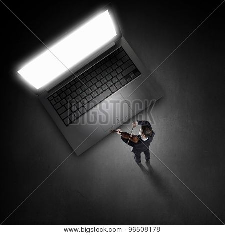 Top view of young businessman playing violin