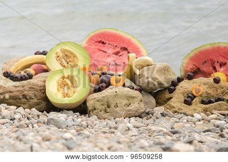 Summer fruits against the sea.