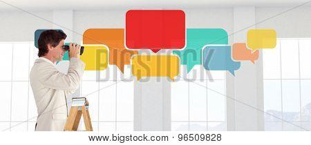 Businessman looking on a ladder against room overlooking ocean