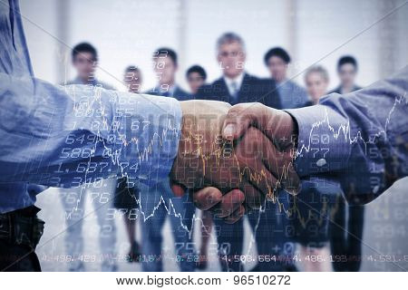 Two men shaking hands against stocks and shares