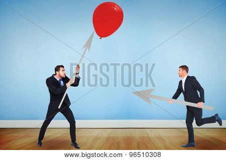 Businessmen atttacking against blue room with wooden floor
