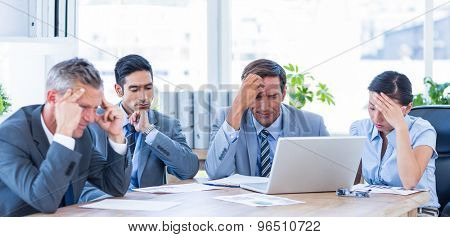 Thoughtful business people during meeting in office