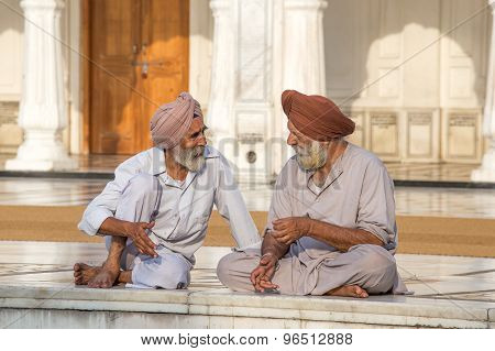 Sikh Men Visiting The Golden Temple In Amritsar, Punjab, India.