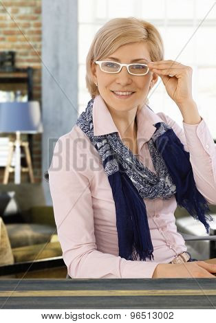 Portrait of happy smiling businesswoman wearing glasses and scarf.
