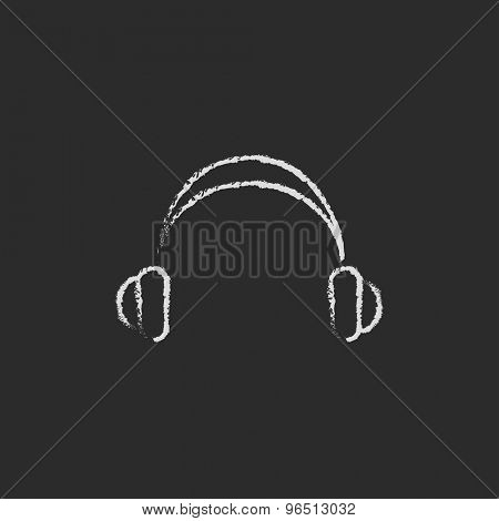 Headphone hand drawn in chalk on a blackboard vector white icon on a black background