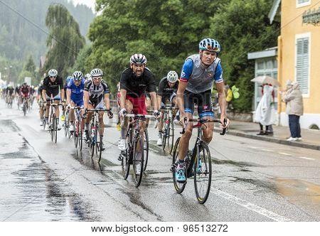 The Peloton Riding In The Rain - Tour De France 2014